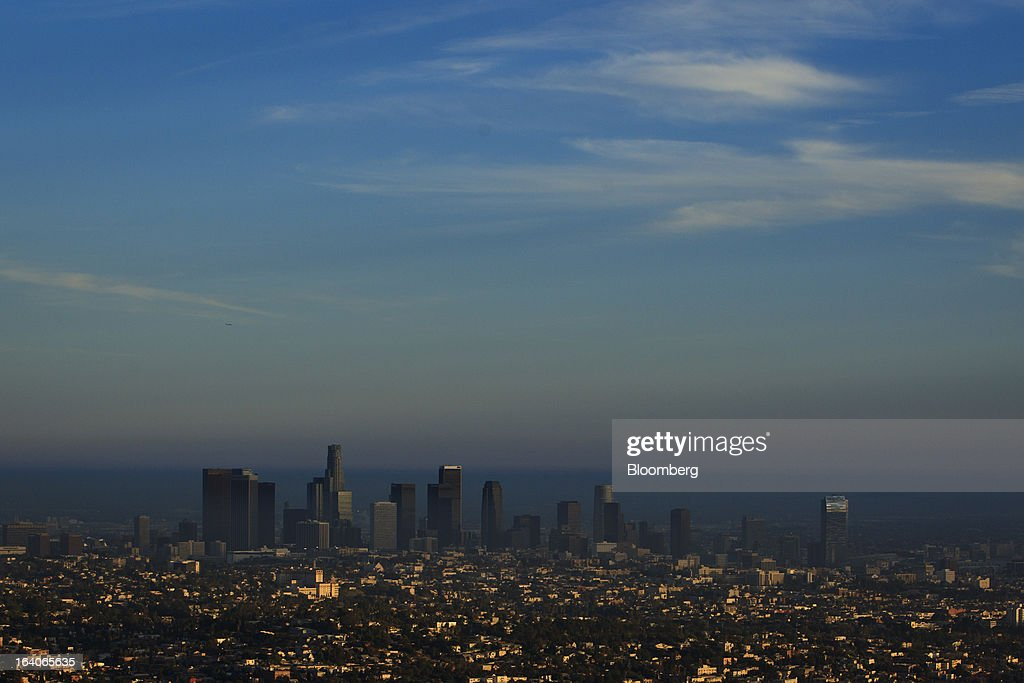 A scenic view of downtown Los Angeles as seen from the Griffith Observatory, featuring the US Bank Tower as well as AEG's LA Live development with the Ritz Carlton Hotel and Staples Center, right, in Los Angeles, California, U.S., on Thursday, March 14, 2013. California should start a state-run bank to finance economic development that's less polluting and more environmentally friendly, financed by auctions of greenhouse-gas carbon credits, Lieutenant Governor Gavin Newsom said. Photographer: Patrick T. Fallon/Bloomberg via Getty Images