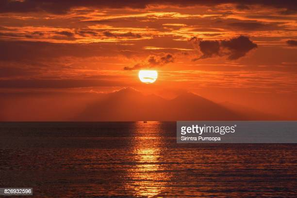 Scenic View Of Dramatic Sky During Sunset over the sea in Flores island, Labuan Bajo, Indonesia