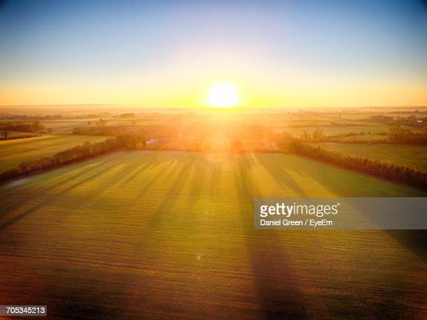 Scenic View Of Field Against Sky During Sunrise