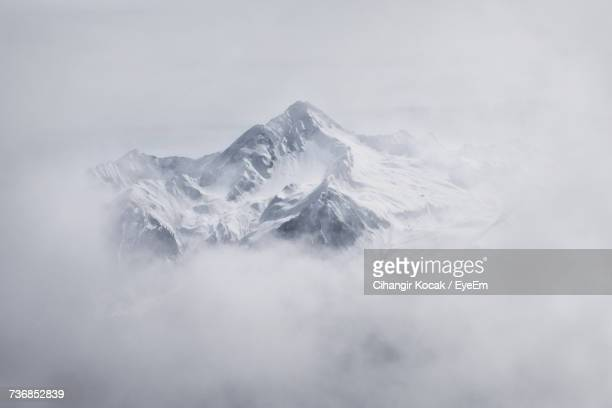 Scenic View Of Frozen Mountain Against Sky