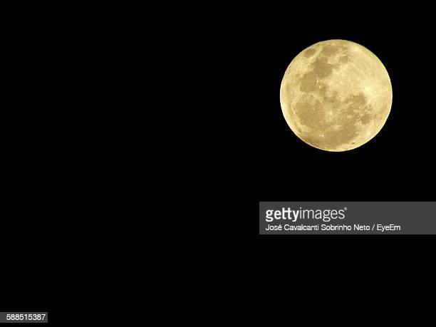 Scenic View Of Full Moon Against Clear Sky At Night