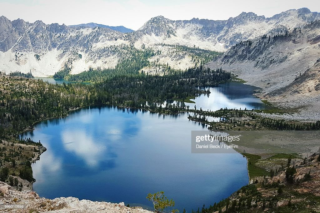 Scenic View Of Goat Lake By Sawtooth Mountains