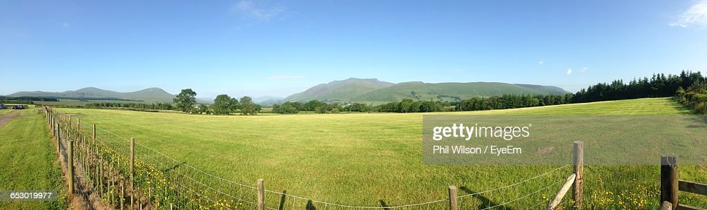 Scenic view of grassy field against sky stock photo getty images scenic view of grassy field against sky stock photo voltagebd Images
