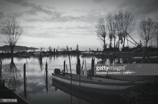 Scenic View Of Harbor Against Cloudy Sky