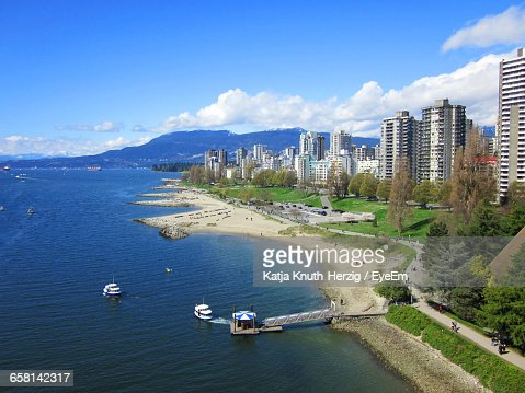 Scenic View Of High Rise Buildings Next To Sea