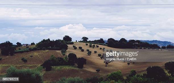 Scenic View Of Hill Against Cloudy Sky