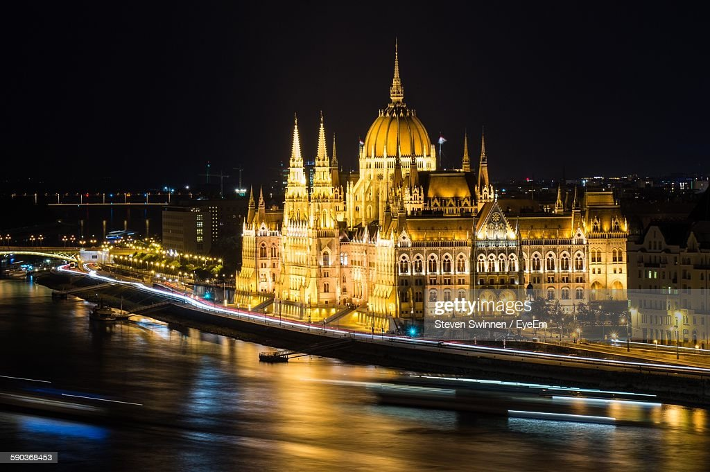 Scenic View Of Illuminated Hungarian Parliament Building At Night