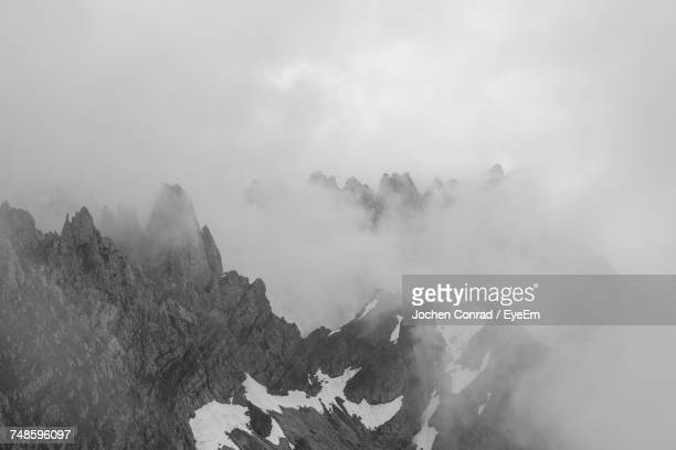 Scenic View Of Kaiser Mountains During Foggy Weather