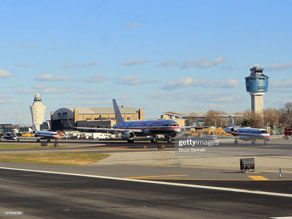 A scenic view of Laguardia airport showing the old and new controller towers photographed from an airplane on December 8 2010 in New York City