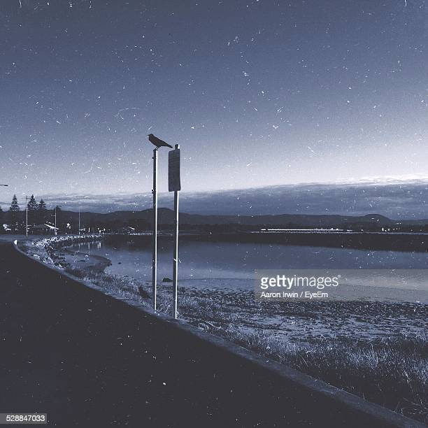 Scenic View Of Lake Against Sky At Dusk During Winter