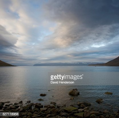 Scenic view of lake and storm clouds : Bildbanksbilder