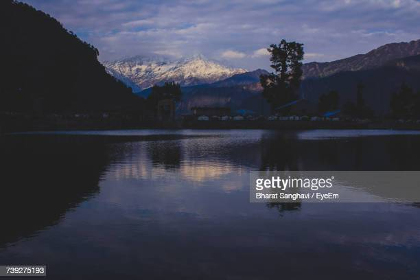 Scenic View Of Lake At Dusk