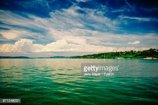 Scenic View Of Lake Constance Against Cloudy Sky
