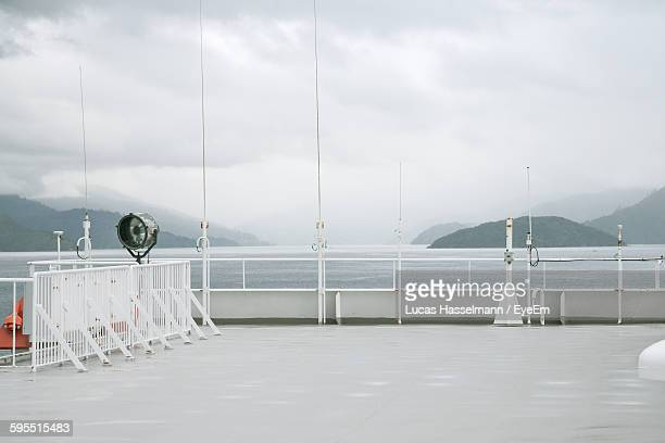 Scenic View Of Lake Seen From Ferry Boat Against Cloudy Sky