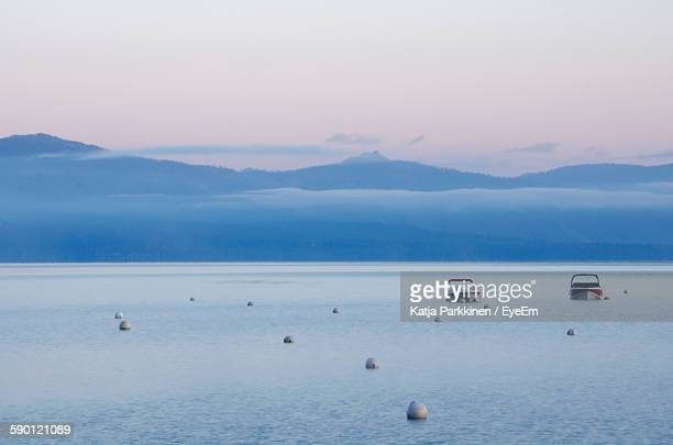 Scenic View Of Lake Tahoe Against Sky During Sunrise