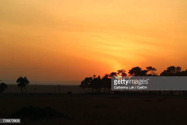Scenic View Of Landscape Against Orange Sky During Sunset