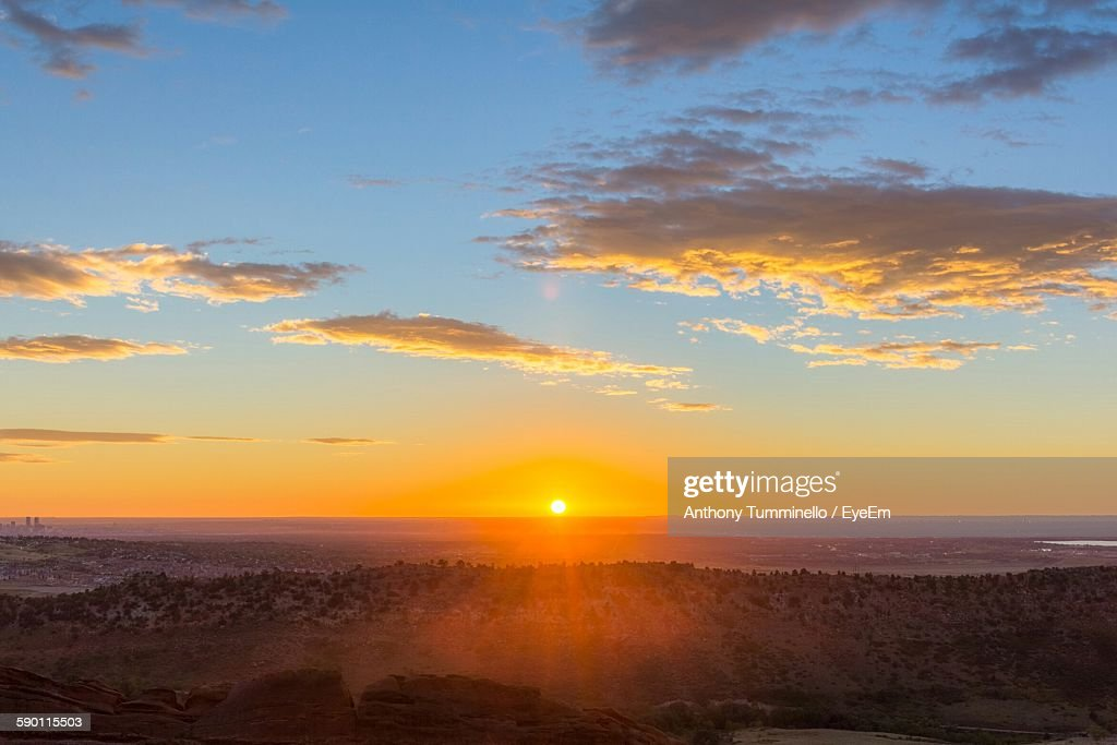 Scenic View Of Landscape Against Sky At Sunrise : Stock Photo