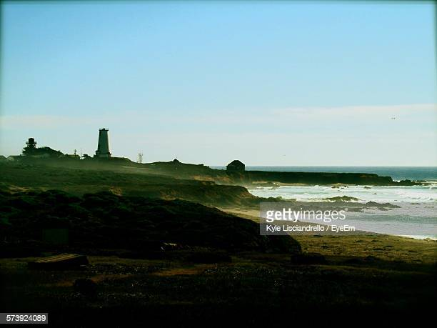 Scenic View Of Landscape By Sea Against Sky