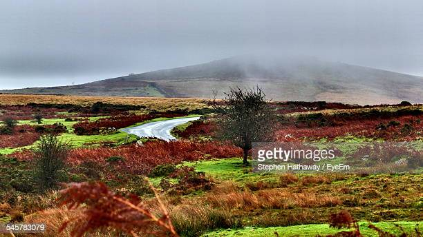 Scenic View Of Landscape In Front Of Dartmoor Against Cloudy Sky