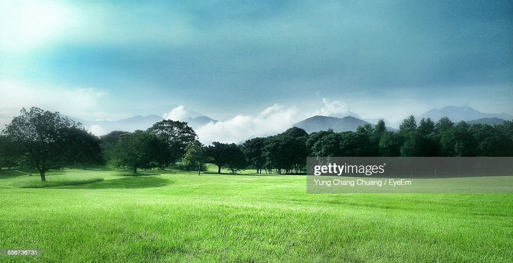 Scenic View Of Landscape With Mountains In Background : Photo
