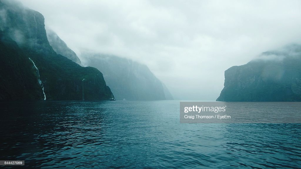 Scenic View Of Milford Sound In Foggy Weather