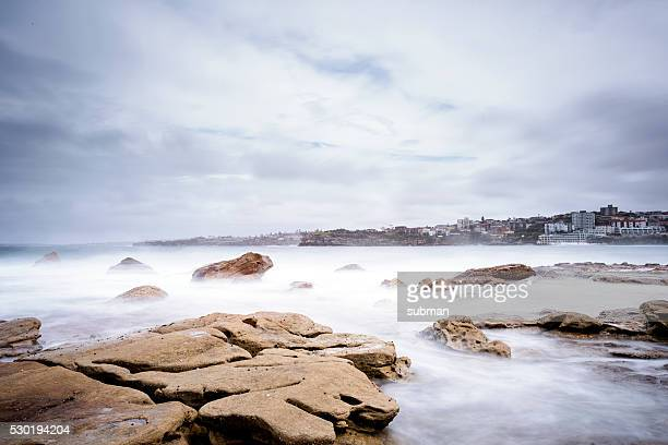 Scenic View Of Mist Over Rocks In The Sea