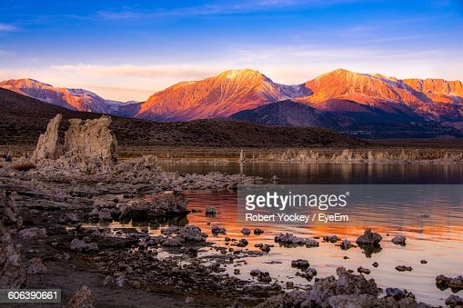 Scenic View Of Mono Lake And Mountains Against Sky During Sunrise