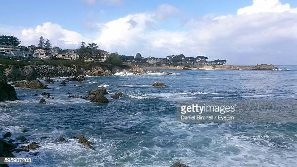 Scenic View Of Monterey Bay Against Cloudy Sky
