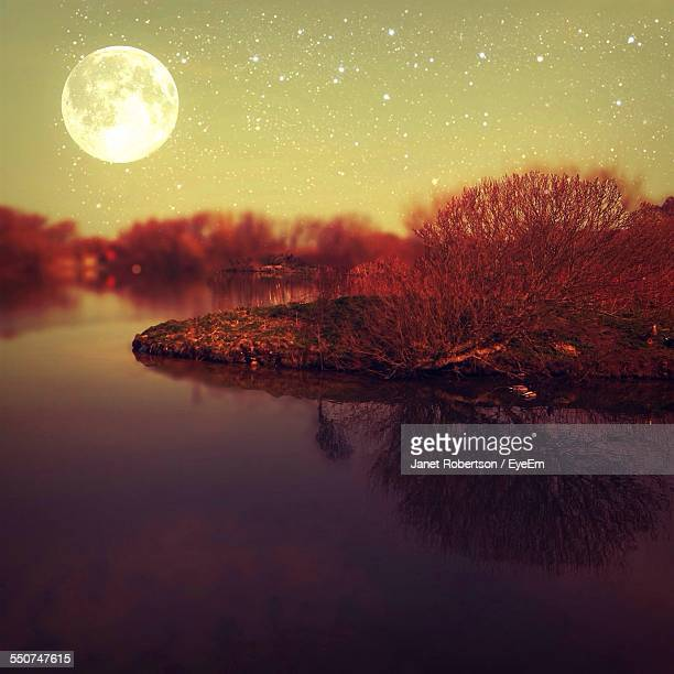 Scenic View Of Moon And Stars In Sky Over River