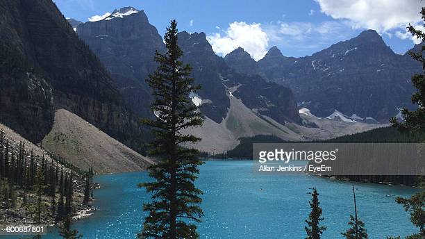 Scenic View Of Moraine Lake Amidst Mountains Against Sky