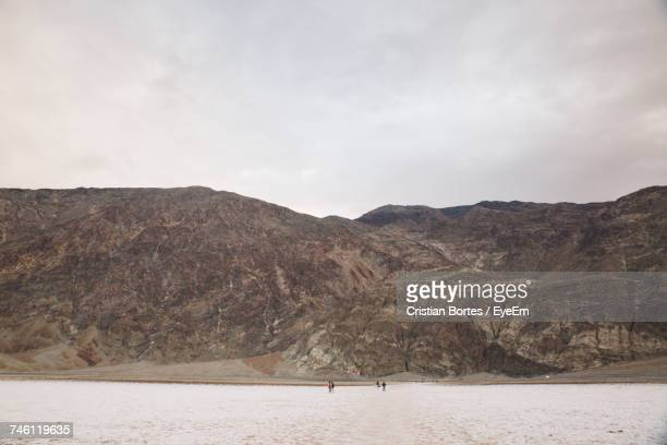 Scenic View Of Mountain Against Cloudy Sky At Death Valley National Park