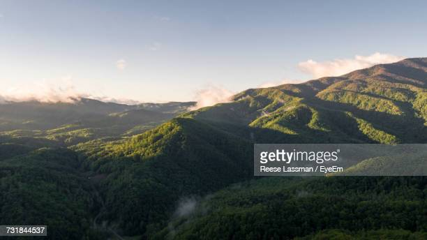 Scenic View Of Mountain Against Cloudy Sky