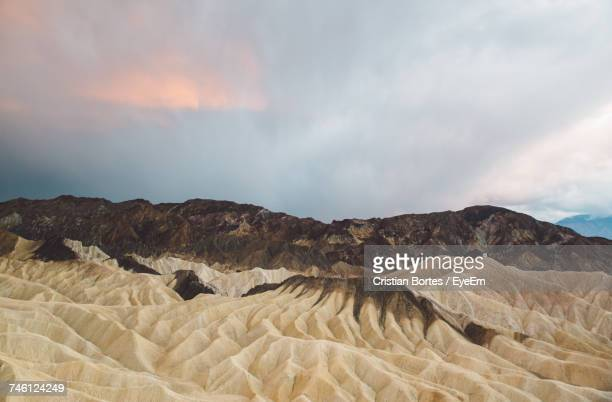 Scenic View Of Mountain At Death Valley National Park Against Cloudy Sky