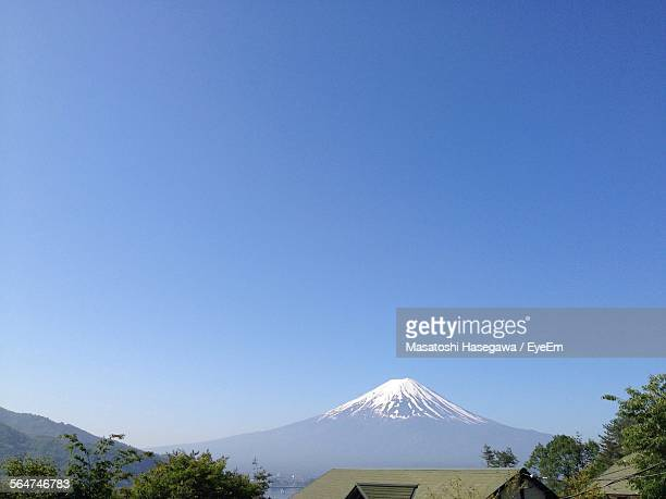 Scenic View Of Mountain Peak Against Blue Sky