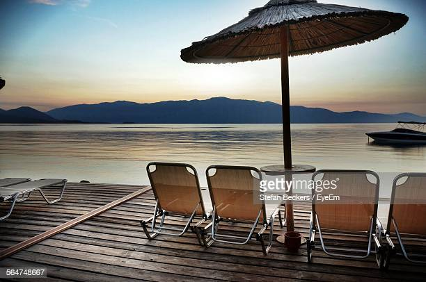 Scenic View Of Mountain, Sea And Beach Chair On Deck