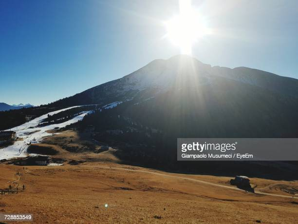 Scenic View Of Mountains Against Clear Sky During Winter