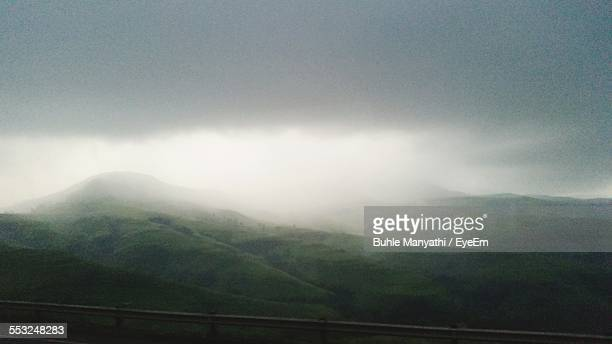 Scenic View Of Mountains Against Cloudy Sky During Monsoon