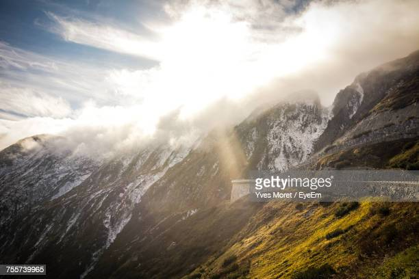 Scenic View Of Mountains Against Cloudy Sky During Winter