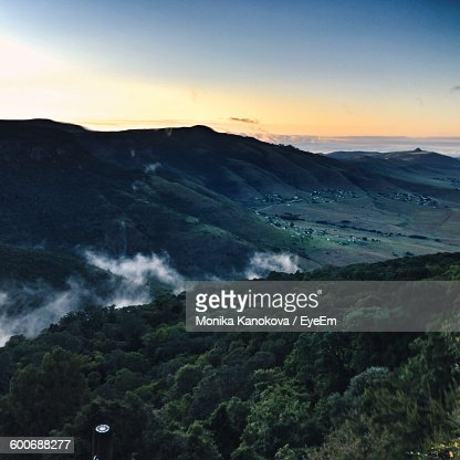 Scenic View Of Mountains Against Sky During Sunrise