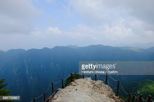 Scenic View Of Mountains Seen From Cliff