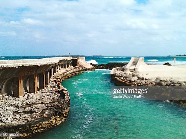 Scenic View Of Old Ruins At Sea Against Cloudy Sky