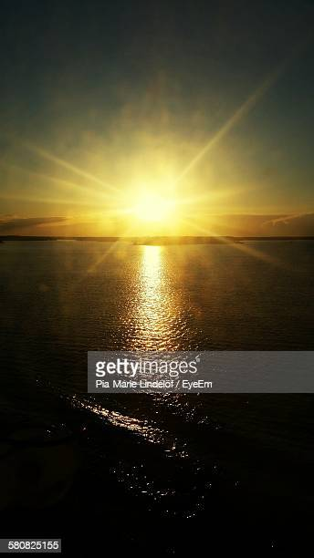 Scenic View Of Orange Sunbeam Falling On Sea At Sunset