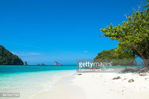 Scenic View Of Paradise Beach Against Clear Blue Sky