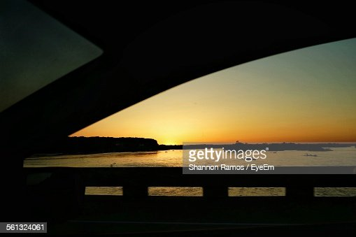 Scenic View Of Platte River Seen Through Car Window During Sunset