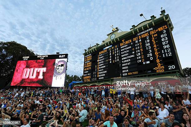A scenic view of play underneath the old scoreboard as supporters cheers the umpires decision displayed on the big screen during the Big Bash League...
