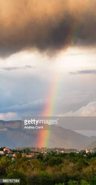Scenic View Of Rainbow Over a Landscape. Missaglia, Lecco, Lombardy