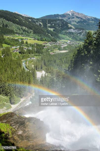 Scenic View Of Rainbow Over Mountains Against Clear Sky