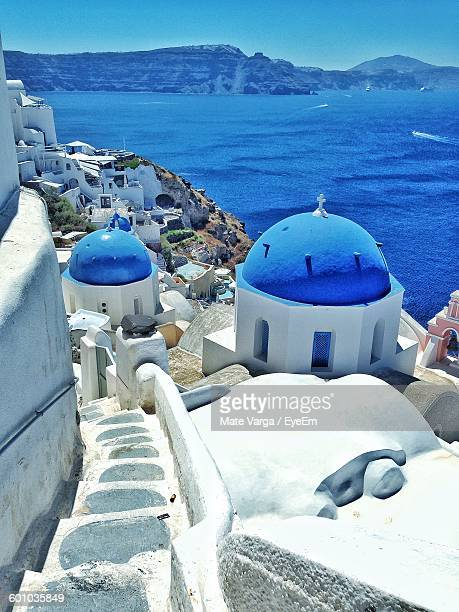 Scenic View Of Residential District In Santorini By Sea