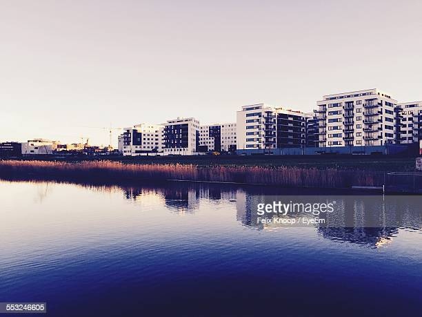 Scenic View Of River Against Buildings In City