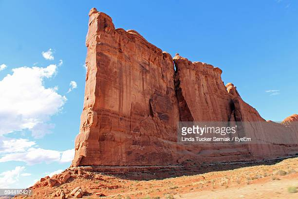 Scenic View Of Rock Formations On Landscape Against Sky